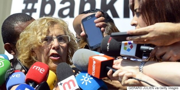 """""""Ahora Madrid"""" citizen platform's candidate for mayor of Madrid, Manuela Carmena addresses journalists after meeting president of Bankia, Jose Ignacio Goirigolzarri, in Madrid on June 03, 2015. Carmena, who could become mayor of Madrid  in June after being second during the last municipal election, has explained to Bankia's president Ahora Madrid's steps to solve the evictions issue.  AFP PHOTO/ GERARD JULIEN        (Photo credit should read GERARD JULIEN/AFP/Getty Images)"""