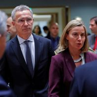 NATO Secretary General Jens Stoltenberg and European Union Foreign Policy Chief Federica Mogherini attend a European Union defence ministers' meeting in Brussels, Belgium, November 13, 2017. REUTERS/Yves Herman