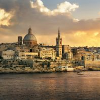 Panoramic view of Valletta at sunset with Carmelite Church dome and St. Pauls Anglican Cathedral. Malta