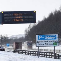 A road sign warns against driving in the snow near Perth, Scotland Britain, February 28, 2018. REUTERS/Russell Cheyne