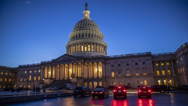 The U.S. Capitol is seen Friday as the Senate worked on a House-passed bill that would pay for President Trump's border wall. After a procedural vote in the Senate, both chambers of Congress adjourned until midday Saturday.