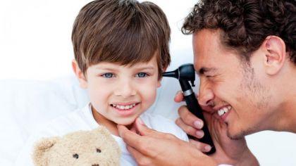 bigstock-Attractive-Doctor-Examining-Pa-6887925