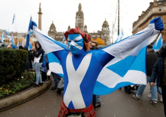 A demonstrator holds a flag during a pro-Scottish Independence rally in Glasgow, Scotland, November 2, 2019.  REUTERS/Russell Cheyne
